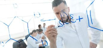 Close up of a Man scientist working with formulas. In the laboratory Stock Image