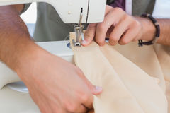 Close up of man sewing Royalty Free Stock Photo