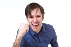 Close up man shaking fist in emotional gesture. Close up portrait of man shaking fist in emotional gesture Stock Photos