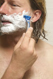 Close-Up Of Man Shaving Face Royalty Free Stock Photos