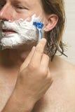 Close-Up Of Man Shaving Face Royalty Free Stock Photos