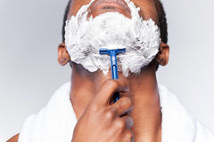 Close up of man shaving. Royalty Free Stock Images