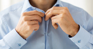 Close up of man in shirt dressing Royalty Free Stock Photos