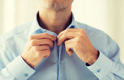 Close up of man in shirt dressing Royalty Free Stock Image