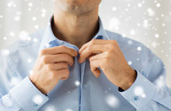 Close up of man in shirt dressing Stock Photo