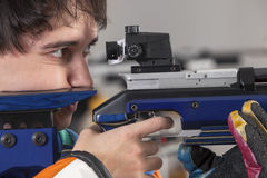 Close-up Of Man Shooting Target. Close-up Of A Male Athlete Doing Target Practice Stock Photo