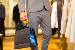 Close up of man with shopping bags at  store Royalty Free Stock Photography
