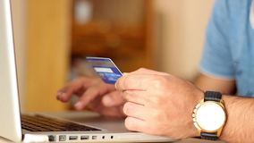 Close up of man shopping online using laptop with credit card. 1920x1080 stock video