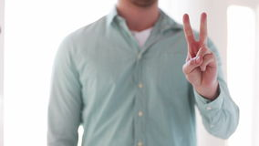 Close up of man showing fingers from one to three Stock Photography