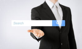 Close up of man showing internet search bar Stock Photography