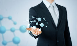 Close up of man showing molecule formula Stock Image