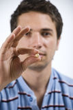 Close up man showing pill Stock Images