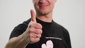 Close up of man showing thumbs up gesture concept, close up of man showing thumbs up.  stock video footage