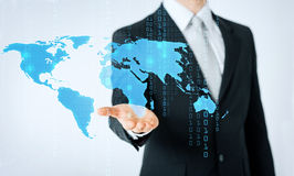Close up of man showing world map and binary code Royalty Free Stock Images