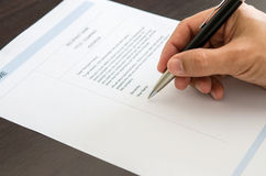 Close-up man signing on resume form. Stock Photography