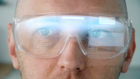 Close up of man in smart glasses with coding