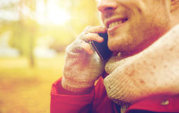 Close up of man with smartphone calling in autumn Stock Photo