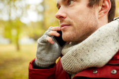 Close up of man with smartphone calling in autumn Royalty Free Stock Photos