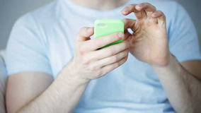 Close up of man with smartphone texting at home stock footage