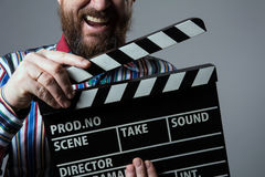 Close-up of a man smiling clapperboard cinema Stock Photos