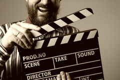 Close-up of a man smiling clapperboard cinema Royalty Free Stock Photos