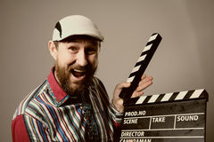 Close-up of a man smiling clapperboard cinema Stock Photography