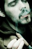 Close up of a man smoking Stock Images