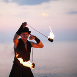 Close up of a man spinning fire poi Royalty Free Stock Photography