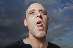 Close-up of a man sticking. His tongue out Royalty Free Stock Photos