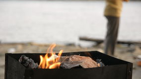 Close-up of a man is stirring a burning coal in a brazier stock video footage