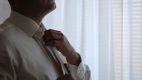 Close-up of a man straightens his tie stock video footage