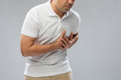 Close up of man suffering from heart ache Stock Photos