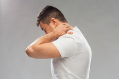 Close up of man suffering from neck pain Royalty Free Stock Photo