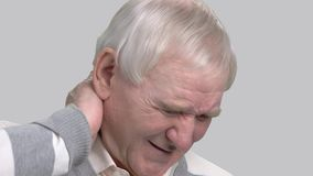 Close up man suffering from neck pain. Pinched nerve or nerve injury concept. How to heal from pinched nerve stock video footage