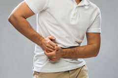 Close up of man suffering from stomach ache Royalty Free Stock Images