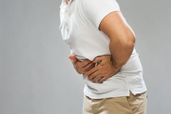 Close up of man suffering from stomach ache Stock Images