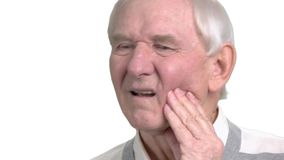 Close up man suffering from toothache. Old man with toothache, white background. How to stop toothache. Remedy for tooth ache stock footage
