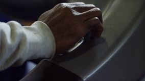 Close-up of man switches speed lever. Man`s hand several times presses lever of switching of speeds in car stock video footage