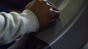 Close-up of man switches speed lever. Man`s hand several times presses lever of switching of speeds in car.  stock photos
