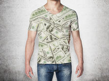 Close-up of a man in a t-shirt crafted from dollar notes. Royalty Free Stock Image