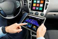 Close up of man with tablet pc in car Stock Images