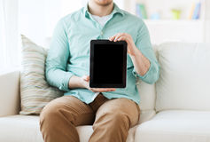 Close up of man with tablet pc computer at home Royalty Free Stock Images