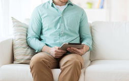 Close up of man with tablet pc computer at home Royalty Free Stock Photo