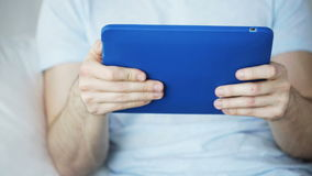 Close up of man with tablet pc computer at home stock footage
