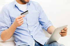 Close up of man with tablet pc and credit card Stock Photos