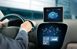 Close up of man with tablet pc driving car Royalty Free Stock Photography