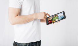Close up of man with tablet pc and web pages Royalty Free Stock Images