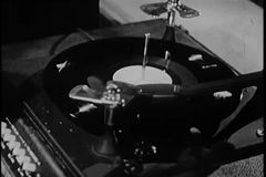 Close-up of man taking needle off record on vintage turntable stock video footage