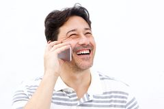 Close up man talking on mobile phone and laughing Royalty Free Stock Image