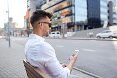 Close up of man texting on smartphone in city Stock Photography